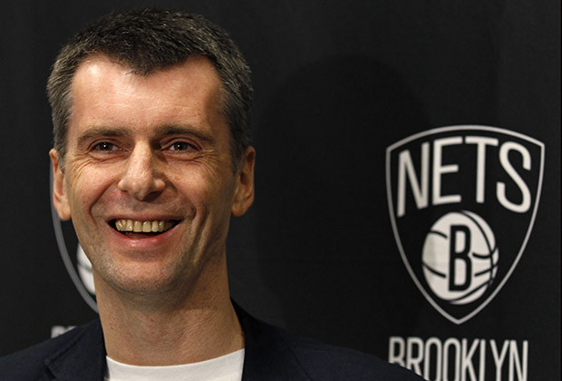 Brooklyn Nets owner Mikhail Prokhorov smiles during an interview before the Nets take on the Minnesota Timberwolves in their NBA basketball game in New York November 5, 2012.