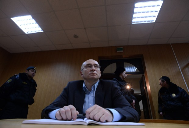 Dmitry Kratov, the prison official accused of causing the death of lawyer Sergei Magnitsky in prison in 2009, sits in a courtroom during his trial in  Moscow on December 28, 2012. Moscow court is to deliver today verdict in trial of Dmitry Kratov. Earlier this week prosecutors moved to drop charges against him. AFP PHOTO / KIRILL KUDRYAVTSEV        (Photo credit should read KIRILL KUDRYAVTSEV/AFP/Getty Images)
