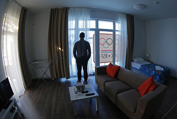 A man stands near the window in a room in the Coastal Athlete's Village at the Olympic Park in Sochi, February 4, 2014. Sochi will host the 2014 Winter Olympic Games from February 7 to February 23.