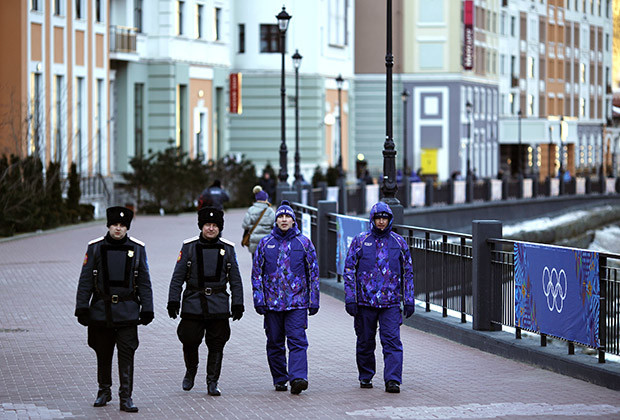 Russian Cossacks patrol near the Rosa Khutor Alpine Resort in Krasnaya Polyana near Sochi February 6, 2014. Sochi will host the 2014 Winter Olympic Games from February 7 to 23.