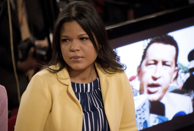 Venezuelan former President Hugo Chavez's daugther, Maria Gabriela, reacts as the National Journalist Award is posthumously granted to her late father, at the Miraflores presidential palace in Caracas on June 27, 2013. AFP PHOTO/Leo RAMIREZ        (Photo credit should read LEO RAMIREZ/AFP/Getty Images)
