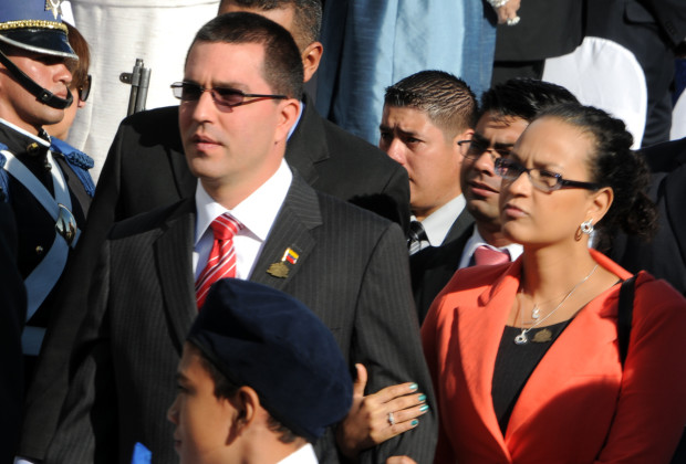 Venezuelan Vice President Jorge Arreaza (C) and his wife Rosa Virginia Chavez attend the inauguration ceremony of the new Honduran President Juan Orlando Hernandez in Tegucigalpa, on January 27, 2014.  AFP PHOTO / Orlando SIERRA.        (Photo credit should read ORLANDO SIERRA/AFP/Getty Images)