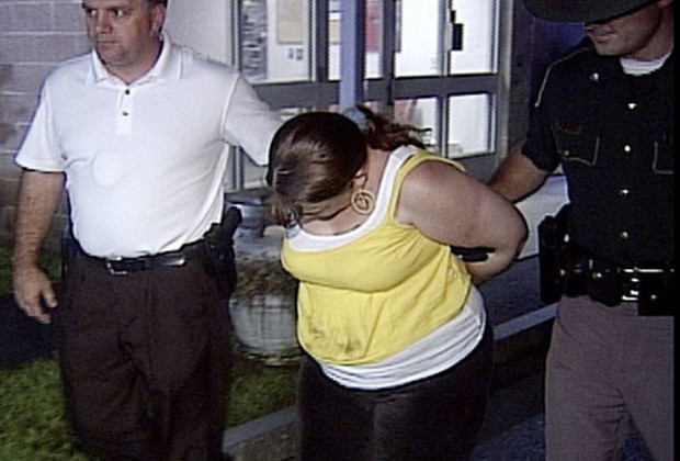 In this image from WMUR television video, 35-year-old Julie Corey is escorted after her arrest in Plymouth, N.H. Wednesday July 29, 2009. Corey is accused of cutting the fetus out of her pregnant friend and then telling others she'd just had a baby girl. (AP Photo/WMUR TV)