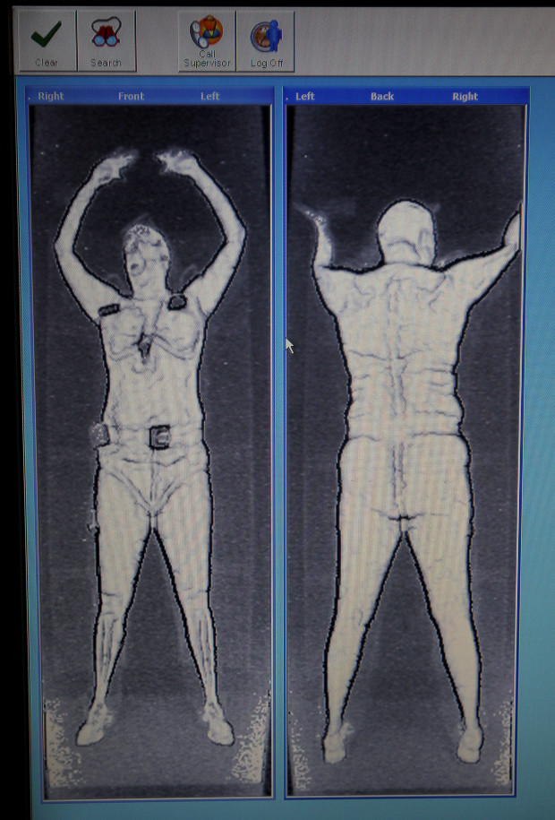 BOSTON ,MA  10 / 04 / 2012: DETAIL OF OLD TYPE SCAN......TSA using new type of advanced imaging technology (AIT) recently installed at Logan International Airport. This new type of body scanner comes with privacy enhancing software that eliminates passenger specific images and, instead identifies anomalies through a generic, computer generated outline of a person. Logan has started installing 27 new machines with the privacy software to replace 17 machines that required a private viewing room because the image is more like a fuzzy photo negative unique to each passenger ( David L Ryan / Globe Staff Photo )   SECTION:  BUSINESS  TOPIC 05tsa