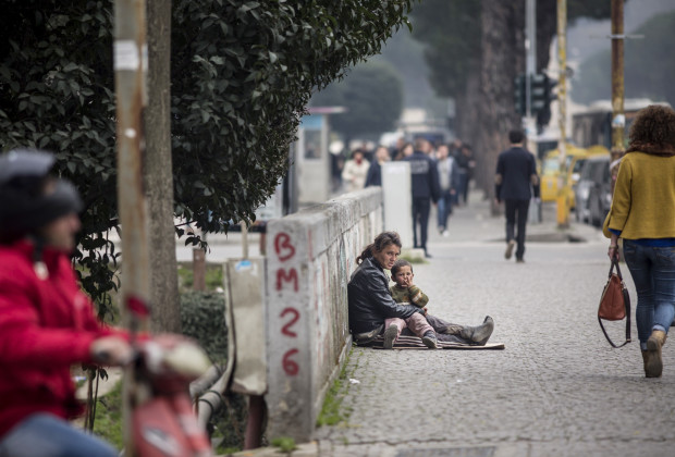 A Roma woman and infant beg on the streets of downtown Tirana, the capital of Albania. Most of the several thousand Roma living there subsist by some form of begging or collecting recyclable trash.  PHOTO BY JODI HILTON