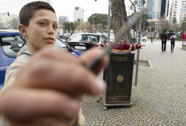 A Roma street child who earns money washing car windows, plays with a nail he found in the trash. PHOTO BY JODI HILTON