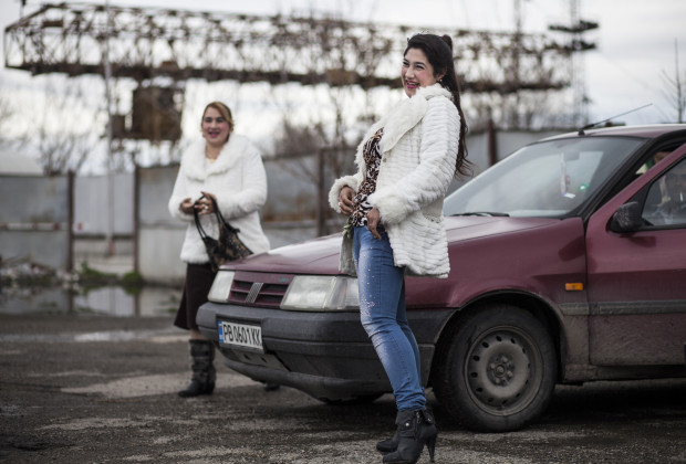 Pepi Hhristova, 19, right, arriving at the annual meeting of the Kalaidzhi clan accompanied by her friend Anka Hristeva, 28. The young girls dress in tight jeans and high-heeled boots in the style of Bulgarian pop stars while their mothers wear traditional velvet dresses and colorful headscarves.