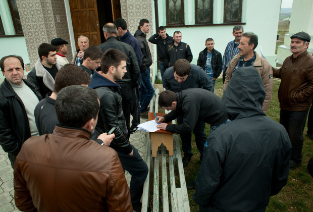 Bakhchysaray, Crimea 2014 Crimean Tatars gathering around a mosque to discuss the latest developments and to sign up to the local civilian defense group.