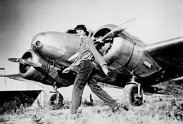 Amelia Earhart, who served as a consultant in the Department of the Study of Careers for Women at Purdue from 1935 to 1937, strides past her Lockheed Electra. Sally Putnam Chapman has donated 492 Earhart items — including rarely seen personal and private papers such as poems, a flight log and a prenuptial agreement — to Purdue Libraries' Earhart collection. (File photo) A publication-quality photograph is available at ftp://ftp.purdue.edu/pub/uns/earhart.newdocs/earhart.electra.jpeg.