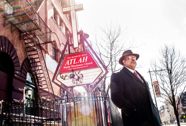 Manhattan, New York - Pastor James David Manning of Atlah World Ministry Church photographed outside his church, Atlah World Ministry Church at 36 W 123rd St in the Harlem neighborhood of Manhattan. Monday, March 24, 2014.  CREDIT: Philip Montgomery for Vocativ