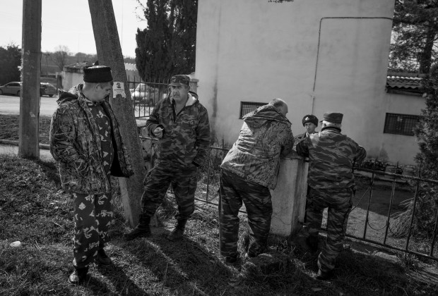 Crimea 2014 Members of Cossack militia chatting to an Ukrainian soldier in a Navy support base that Cossack militia is surrounding., Sevastopol