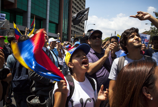 March 12th, 2014. Caracas. Students cheer in Bello Monte at the rally. One month after student protests over violence, inflation and food shortages convulsed Venezuela, resulting in the deaths of 3 people on that first day of unrest alone, thousands of students took to the streets in Caracas on Wednesday morning in parallel rallies, one to support the government, the other condemning this month's violence against protesters and continuing to call for change. At least 3,0000 students attempted to march to the offices of the government Public Defender's offices in Caracas to protest allegations of torture of detained protesters. National police blocked the students exit from the Central University of Venezuela, and after negotiations failed, the students attempted to push through the police lines, and were met with water canons, tear gas, and bird shot.