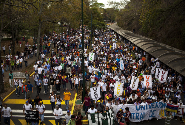 March 12th, 2014. Caracas. Thousands of students march through the Central University of Venezuela Campus. One month after student protests over violence, inflation and food shortages convulsed Venezuela, resulting in the deaths of 3 people on that first day of unrest alone, thousands of students took to the streets in Caracas on Wednesday morning in parallel rallies, one to support the government, the other condemning this month's violence against protesters and continuing to call for change. At least 3,0000 students attempted to march to the offices of the government Public Defender's offices in Caracas to protest allegations of torture of detained protesters. National police blocked the students exit from the Central University of Venezuela, and after negotiations failed, the students attempted to push through the police lines, and were met with water canons, tear gas, and bird shot.