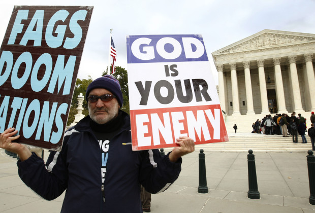 Fred Phelps Jr. protests his side of the Snyder V. Phelps case outside the U.S. Supreme Court in Washington October 6, 2010. The Supreme Court hears oral arguments in the case on whether an individual's interest in suing to recover for the disruption of a family member's funeral outweighs the disrupter's First Amendment right to freedom of speech.  REUTERS/Kevin Lamarque (UNITED STATES - Tags: POLITICS LAW) - RTXT46A