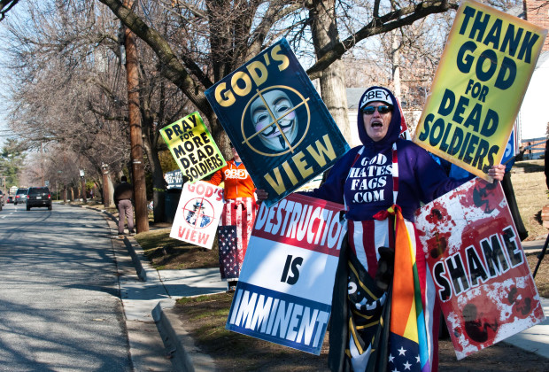 """Shirley Phelps-Roper (R) and her daughter Megan of the Westboro Baptist Church, a Kansas church known for its vehement anti-gay positions and for protesting at US soldiers' funeral, stage a protest across the street from Northwestern High School in Hyattsville, Maryland, outside Washington, on March 1, 2011. The church was demonstrating against what it claims is a """"pervert-run"""" school and said teachers across the country have """"broken the moral compass of this generation.""""         AFP PHOTO/Nicholas KAMM (Photo credit should read NICHOLAS KAMM/AFP/Getty Images)"""