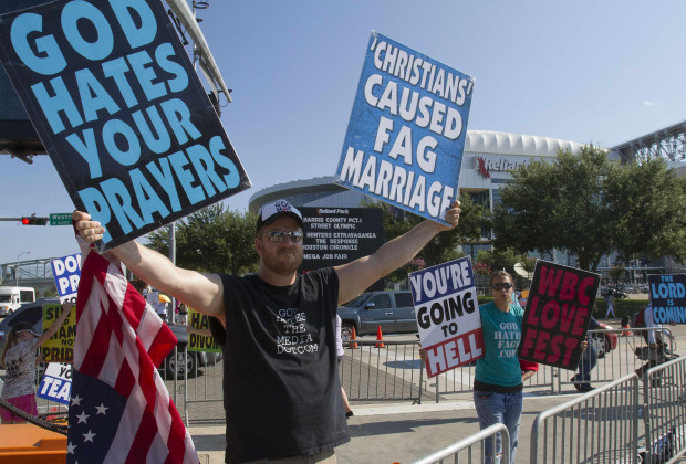 """Members of the Westboro Baptist Church of Topeka, Kansas, protest outside the venue of """"The Response"""",  an event billed by its organizer, Texas Governor Rick Perry, as a call to prayer for a nation in crisis, at the Reliant stadium in Houston August 6, 2011.     REUTERS/Richard Carson    (UNITED STATES - Tags: POLITICS RELIGION CIVIL UNREST SOCIETY) - RTR2PO7Q"""
