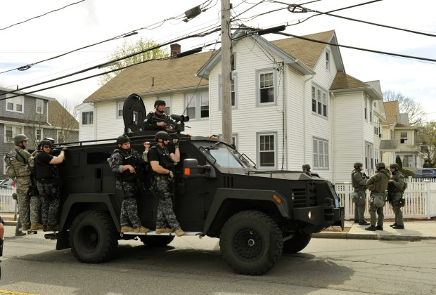 A police SWAT team search houses for the second of two suspects wanted in the Boston Marathon bombings takes place April 19, 2013 in Watertown, Massachusetts. Thousands of heavily armed police staged an intense manhunt Friday for a Chechen teenager suspected in the Boston marathon bombings with his brother, who was killed in a shootout. Dzhokhar Tsarnaev, 19, defied the massive force after his 26-year-old brother Tamerlan was shot and suffered critical injuries from explosives believed to have been strapped to his body.      AFP PHOTO / TIMOTHY A. CLARY        (Photo credit should read TIMOTHY A. CLARY/AFP/Getty Images)