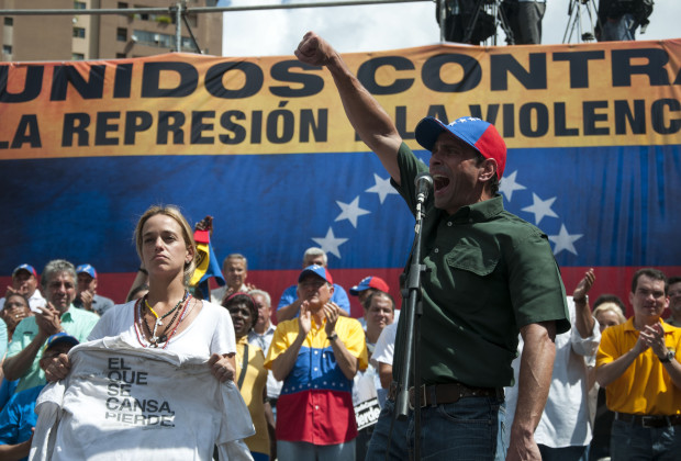 CARACAS, VENEZUELA - FEBRUARY 22 : Opposition leader Henrique Capriles Radonski (R) and Lilian Tintori (L), wife of arrested opposition leader Leopoldo Lopez attends an anti-government demonstration in the streets of Caracas, Venezuela, on February 22, 2014. (Photo by Cristian Hernandez/Anadolu Agency/Getty Images)