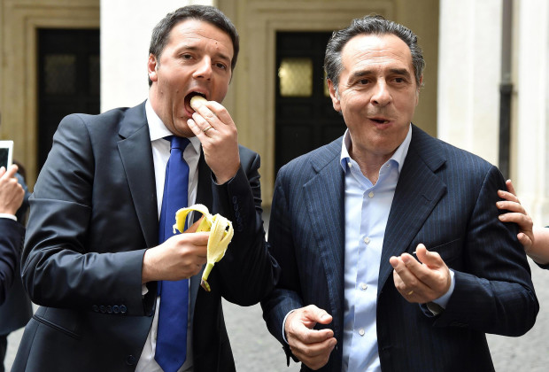 Premier Matteo Renzi (L) and Italy coach Cesare Prandelli ate bananas, copying Barcelona Dani Alves's reaction to racist abuse.