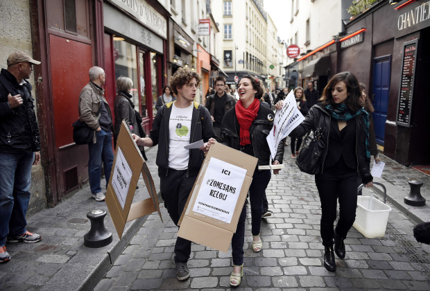 Demonstrators paste flyers on walls as they take part in a protest against sexual and verbal harassment, on April 25, 2014, in Paris. A group of protesters, including both men and women, gathered in Paris today to denounce sexual and verbal harassment which occurs everyday in the streets.