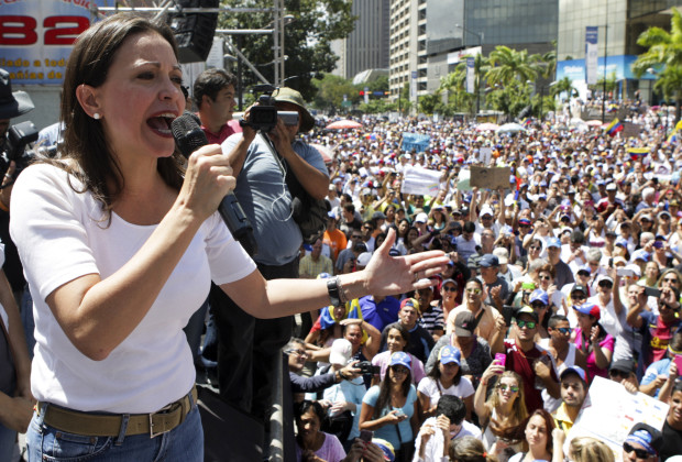 Opposition leader Maria Corina Machado speaks during a protest against President Nicolas Maduro's government in Caracas February 16, 2014. The demonstrators have vowed to stay in the streets until Maduro resigns, although there is no sign of that happening. REUTERS/Christian Veron (VENEZUELA - Tags: POLITICS CIVIL UNREST) - RTX18YET