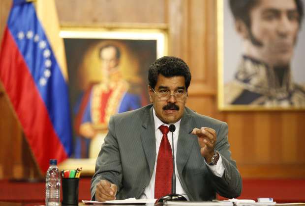 """Venezuela's President Nicolas Maduro speaks during a news conference at Miraflores palace in Caracas March 14, 2014. Venezuela's foreign minister lambasted U.S. Secretary of State John Kerry on Friday as a """"murderer"""" fomenting unrest that has killed 28 people in the South American OPEC member nation. REUTERS/Carlos Garcia Rawlins (VENEZUELA - Tags: POLITICS) - RTR3H51B"""