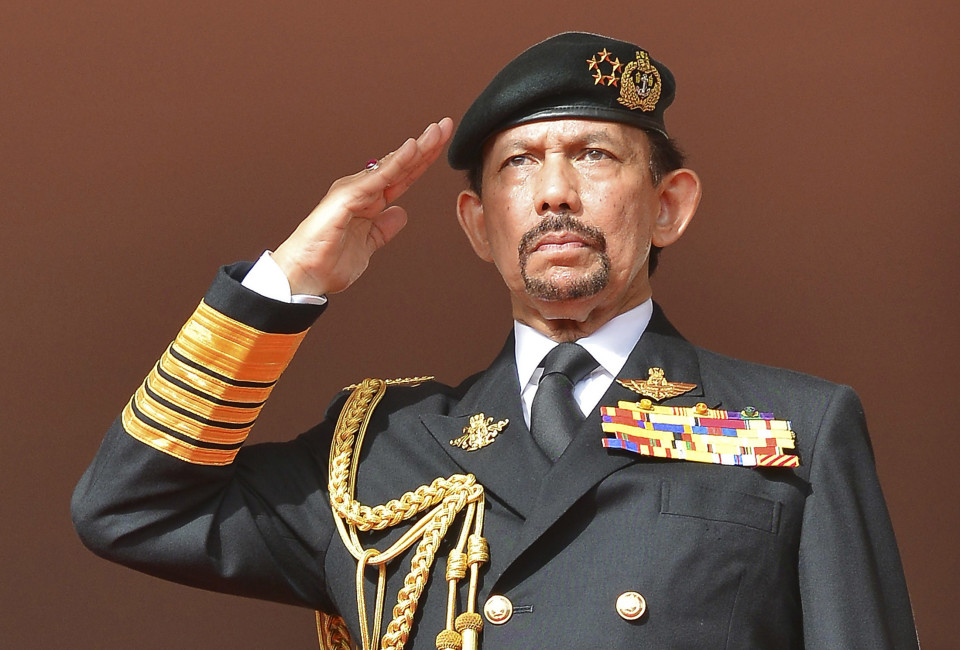 Brunei's Sultan Hassanal Bolkiah salutes as the national anthem is played during celebrations for Brunei's 30th National Day, in Bandar Seri Begawan. February 23, 2014.