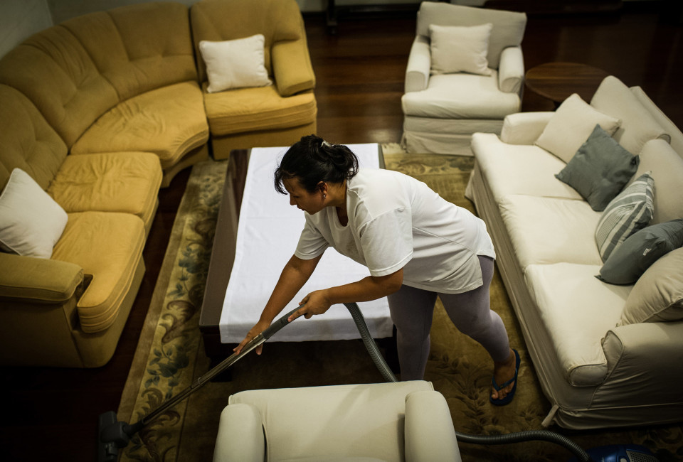 Brazilian Cassia Mendes, who has been working as a housekeeper for more than 20 years, cleans a house in Sao Paulo, Brazil.