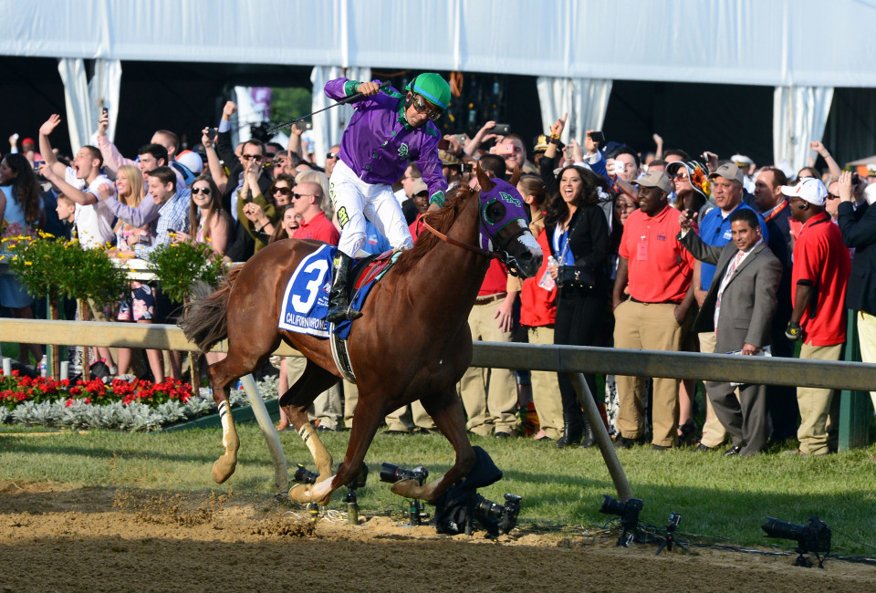 May 17, 2014; Baltimore, MD, USA; Victor Espinoza aboard California Chrome celebrates winning the 139th Preakness Stakes at Pimlico Race Course.