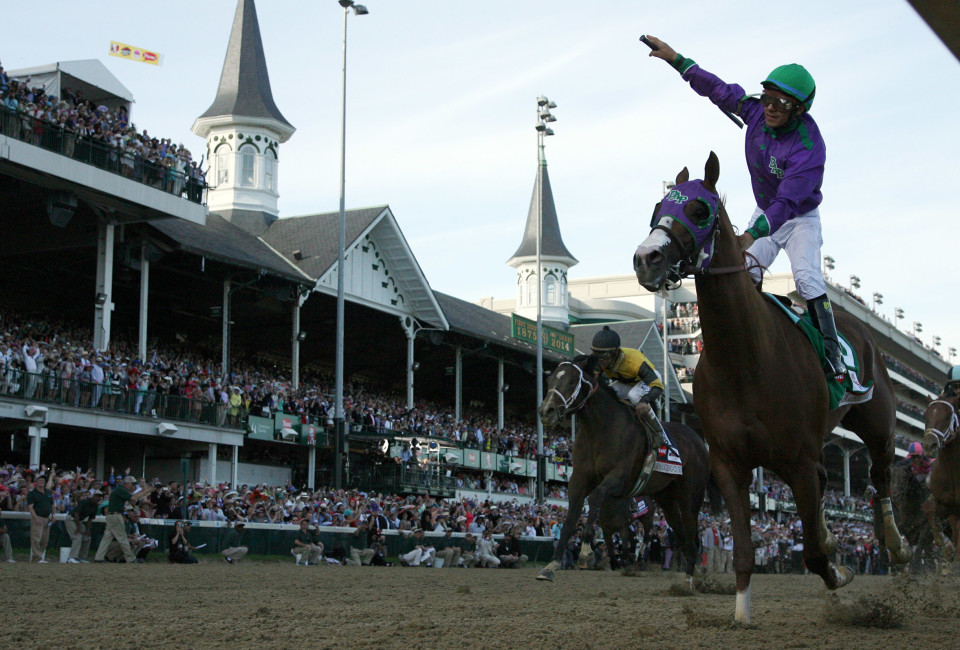 May 3, 2014; Louisville, KY, USA; California Chrome jockey Victor Espinoza (5) celebrates after winning the 2014 Kentucky Derby.
