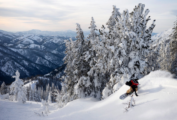Joey Howell slashes the snow during a tour on Teton Pass outside of Jackson, Wyoming on Jan. 15, 2014.  A storm dropped close to four feet of snow in a matter of days, offering up great riding conditions but dangerously high avalanche conditions.     JAMES ROH