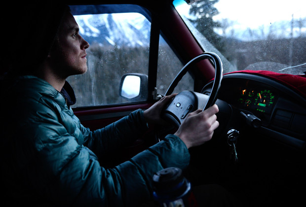 Joey Howell drives north to Alaska via the Stewart Cassiar Highway in the Yukon Territory on March 22, 2014.  James Roh and Joey Howell purchased an old Ford F-350 and attached a winterized truck camper to provide mobile shelter for the journey.      JAMES ROH
