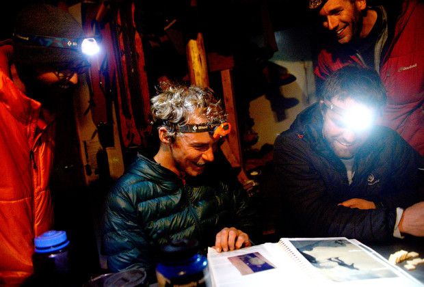 Spenser Heaps, left, and Joey Howell, center, share a laugh with hut mates at the Snowbird Hut during the last night of the Bomber Traverse in the Talkeetna Mountains of Alaska on April 18, 2014.    JAMES ROH