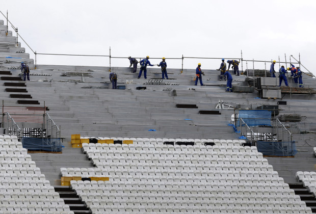 Labourers work in the construction site of the Arena de Sao Paulo Stadium, one of the venues for the 2014 World Cup, in Sao Paulo.CUP) - RTR3MQJX