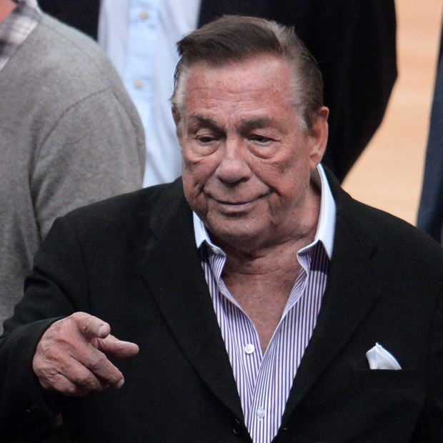 """Los Angeles Clippers owner Donald Sterling attends the NBA playoff game between the Clippers and the Golden State Warriors on April 21, 2014 at Staples Center in Los Angeles, California. The NBA banned Sterling for life for """"deeply offensive and harmful"""" racist comments that sparked a national firestorm. NBA Commissioner Adam Silver hit Sterling with every penalty at his disposal, fining him a maximum $2.5 million dollars and calling on other owners to force him to sell his team.   AFP PHOTO / ROBYN BECK        (Photo credit should read ROBYN BECK/AFP/Getty Images)"""