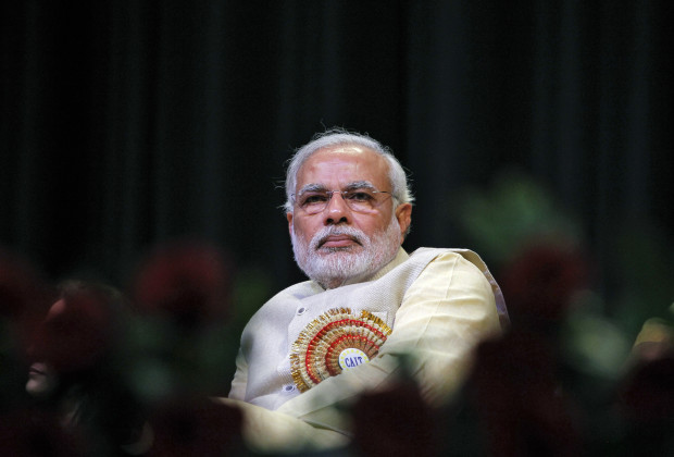 Hindu nationalist Narendra Modi, prime ministerial candidate for India's main opposition Bharatiya Janata Party (BJP) and Gujarat's chief minister, attends the Confederation of All India Traders (CAIT) national convention in New Delhi February 27, 2014. Modi said on Thursday the country's millions of family-owned traders must learn to work with large modern shops and online retailers, in comments that could signal a shift in thinking. REUTERS/Stringer (INDIA - Tags: POLITICS BUSINESS PROFILE) - RTR3FRPI