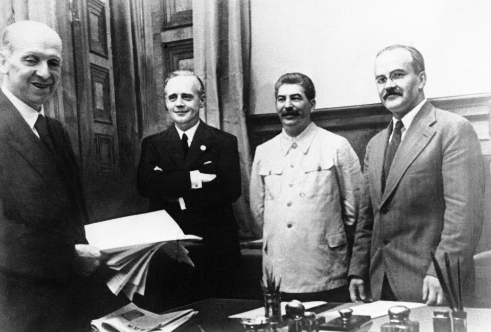 The scene in Moscow on August 23, 1939, after representatives of Nazi Germany and Soviet Russia signed their ten year Non Aggression Pact. Shown from left to right are:  Freidrich Gaus, Joachim von Ribbentrop, Vyacheslav Molotov, and Joseph Stalin. Molotov signed for Russia and von Ribbentrop signed for Germany.