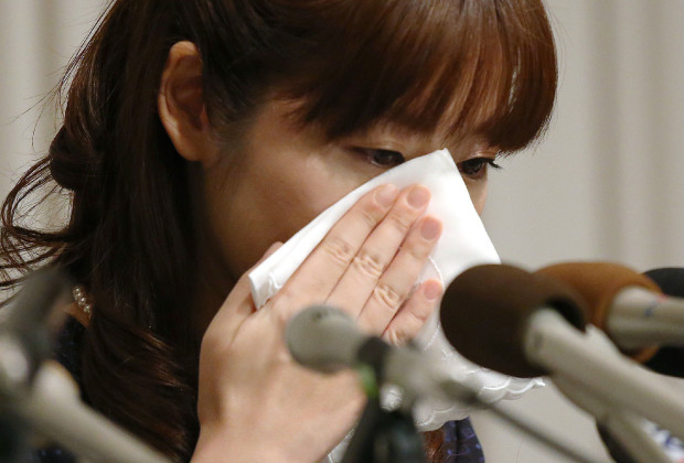 """Haruko Obokata, 30, a female researcher of Japan's Riken Institute wipes away tears during a press conference in Osaka, western Japan on April 9, 2014. A young female scientist accused of fabricating data made a tearful apology live on Japanese television on April 9 for """"mistakes"""" in her research, but insisted her ground-breaking conclusions on stem cells were accurate. AFP PHOTO / JIJI PRESS    JAPAN OUT        (Photo credit should read JIJI PRESS/AFP/Getty Images)"""