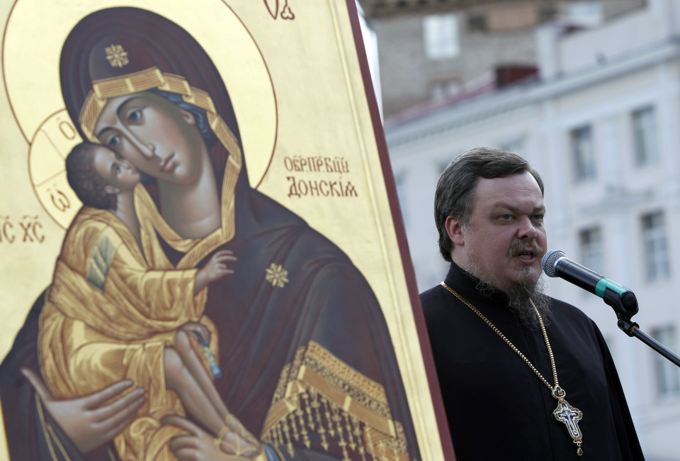 Archpriest Vsevolod Chaplin speaks during a rally in support of Russian Orthodox Church and Patriarch Kirill in Moscow.