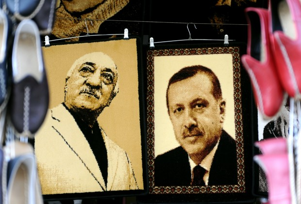 Embroidered images of United States-based Turkish cleric Fethullah Gulen (L) and Turkey's Prime Minister Recep Tayyip Erdogan (R) are displayed in a shop in the Gaziantep market on January 17, 2014 in Gaziantep, near the Turkish-Syrian border. AFP PHOTO / OZAN KOSE        (Photo credit should read OZAN KOSE/AFP/Getty Images)