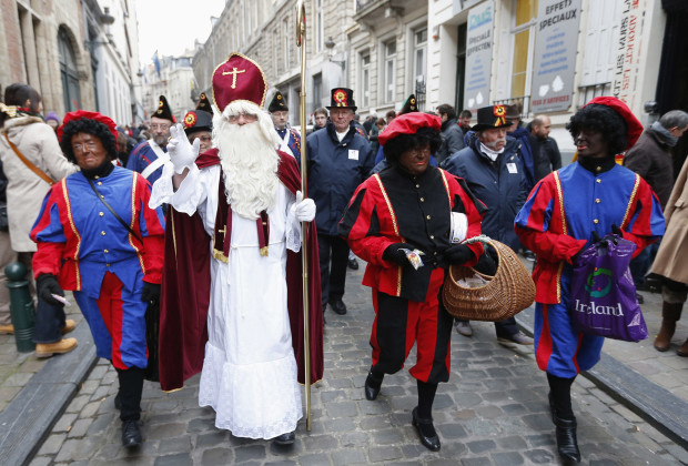 "Saint Nicholas (2nd L) is escorted by his three assistants called ""Zwarte Piet"" (Black Pete) during a traditional parade."