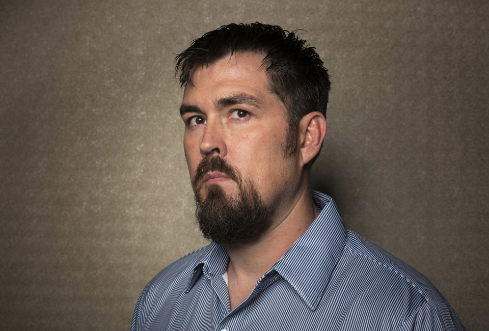 "Former U.S. Navy SEAL Marcus Luttrell poses for a portrait while promoting the film ""Lone Survivor"" in New York, December 5, 2013."