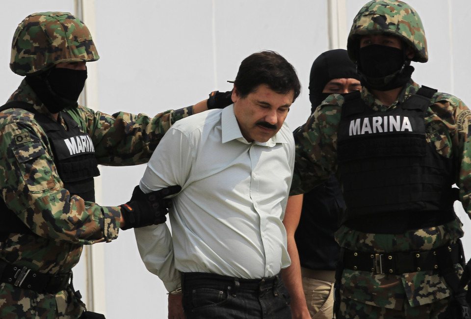 "Joaquin ""Shorty"" Guzman (C) is escorted by soldiers during a presentation at the Navy's airstrip in Mexico City February 22, 2014. Mexico has captured its most wanted man, drug kingpin Guzman, President Enrique Pena Nieto said via Twitter on Saturday, in a major victory in a long, grisly fight against drug gangs. Guzman, known as ""El Chapo"" (Shorty) in Spanish, runs Mexico's infamous Sinaloa Cartel and over the past decade emerged as one of the world's most powerful organized crime bosses.  REUTERS/Henry Romero (MEXICO - Tags: CIVIL UNREST CRIME LAW DRUGS SOCIETY MILITARY TPX IMAGES OF THE DAY) - RTX19BXJ"