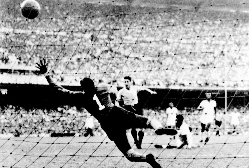 Uruguayan forward Juan Alberto Schiaffino (C) kicks the ball past Brazilian goalkeeper Moacyr Barbosa to tie the score at 1 during the World Cup final round soccer match between Uruguay and Brazil 16 July 1950 in Rio de Janeiro. Uruguay upset Brazil 2-1 to win its second World title after winning the first World Cup in 1930 in Uruguay.
