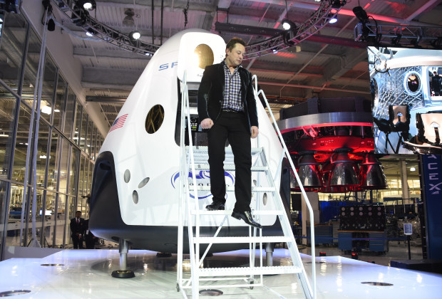 SpaceX CEO Elon Musk unveils SpaceX's new seven-seat Dragon V2 spacecraft, in Hawthorne, California on May 29, 2014.  The private spaceflight companys new manned space capsule will ferry NASA astronauts to and from the International Space Station. AFP PHOTO / Robyn Beck        (Photo credit should read ROBYN BECK/AFP/Getty Images)
