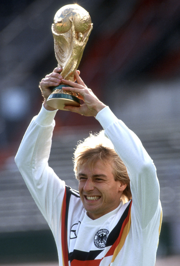 Jurgen Klinsmann poses with World Cup trophy after Germany won the 1990 FIFA World Cup finale against Argentina in Italy.