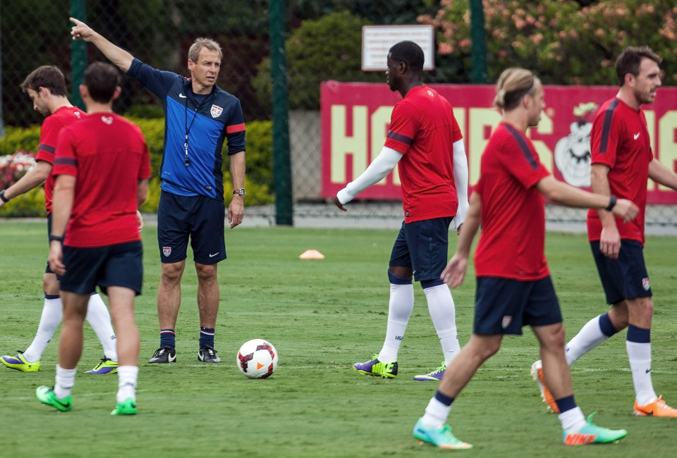 U.S. national soccer team head coach Jurgen Klinsmann (3rd L) gives instructions to his players during a training session in Sao Paulo January 14, 2014.