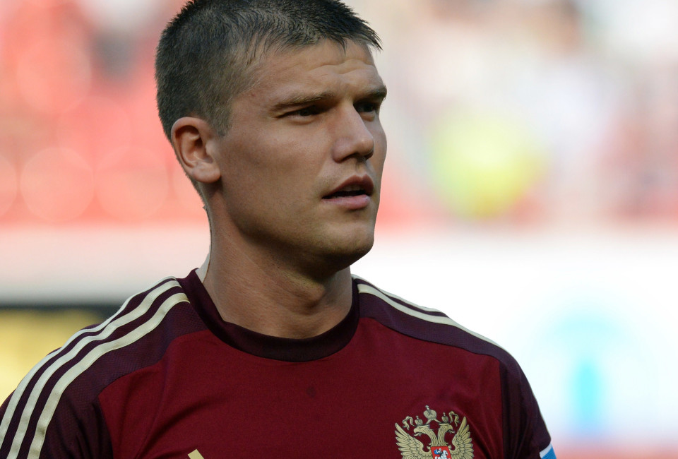 Russia's mildfielder Igor Denisov listens to the national anthems, before the start of the friendly football match between Russia and Morocco, in Moscow, on June 6, 2014, in preparation of the FIFA World Cup 2014 in Brazil.