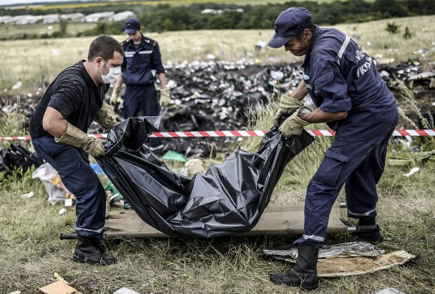 Ukrainian State Emergency Service employees collect bodies of victims at the site of the crash of a Malaysia Airlines plane in Grabove, in rebel-held east Ukraine on July 20, 2014. The missile system used to shoot down a Malaysian airliner was handed to pro-Russian separatists in Ukraine by Moscow, the top US diplomat said Sunday. Outraged world leaders have demanded Russia's immediate cooperation in a prompt and independent probe into the shooting down on July 17 of flight MH17 with 298 people on board.