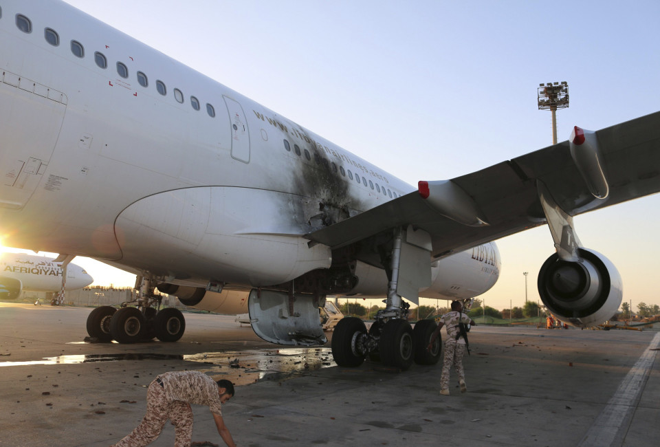 A damaged aircraft is pictured after a shelling at Tripoli International Airport.